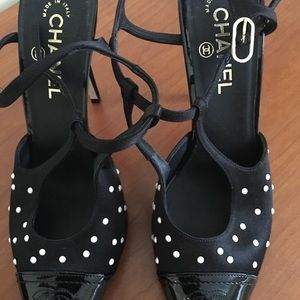 Black Chanel heels with pearls